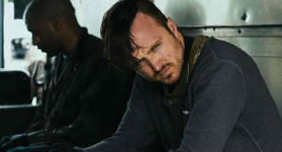 Aaron Paul Talks 'Triple 9,' Brotherly Bond With Norman Reedus